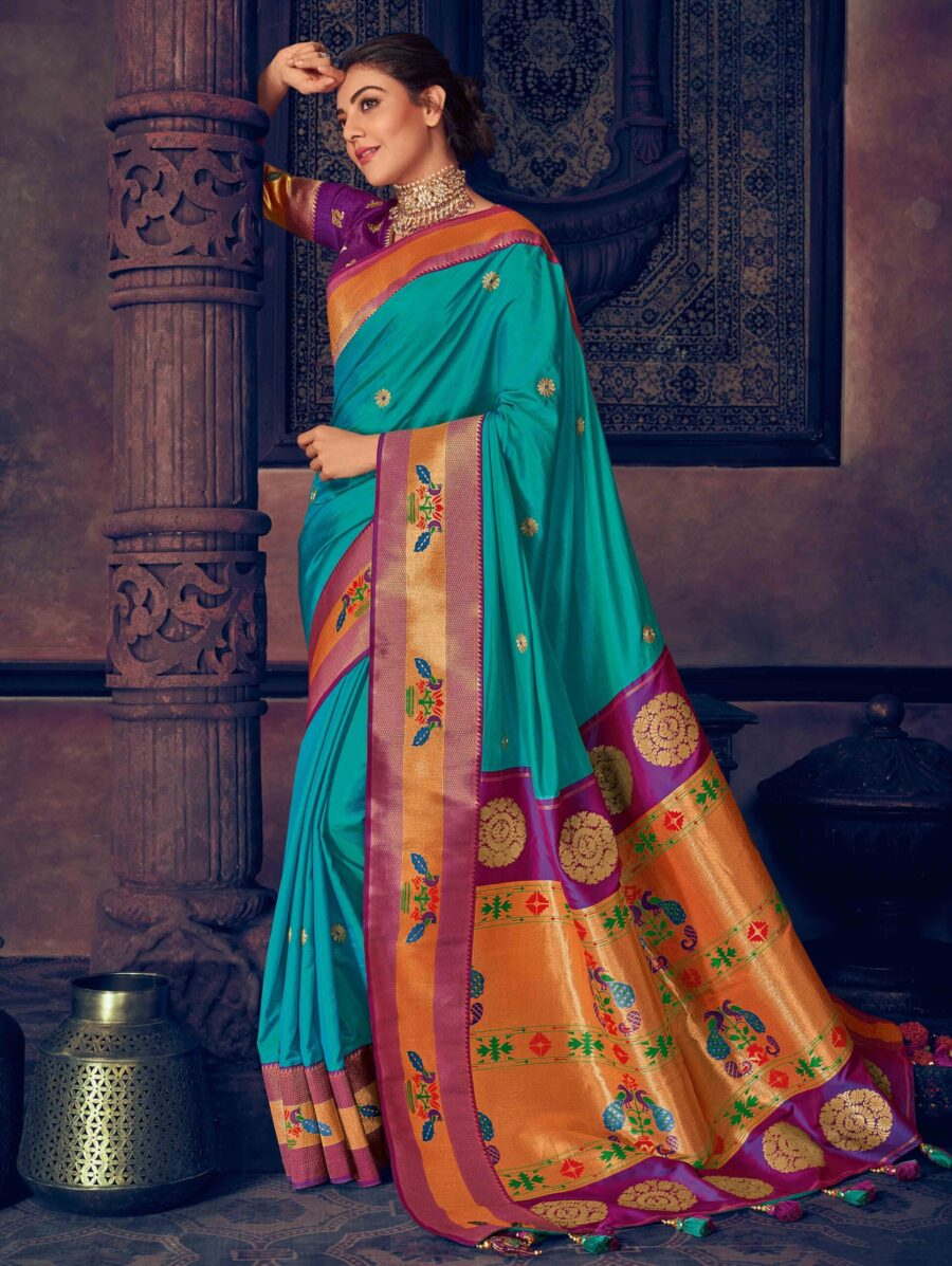 Kajal Aggarwal Turquoise Blue Silk Saree with Peacock Motif Contrast Border and Pallu