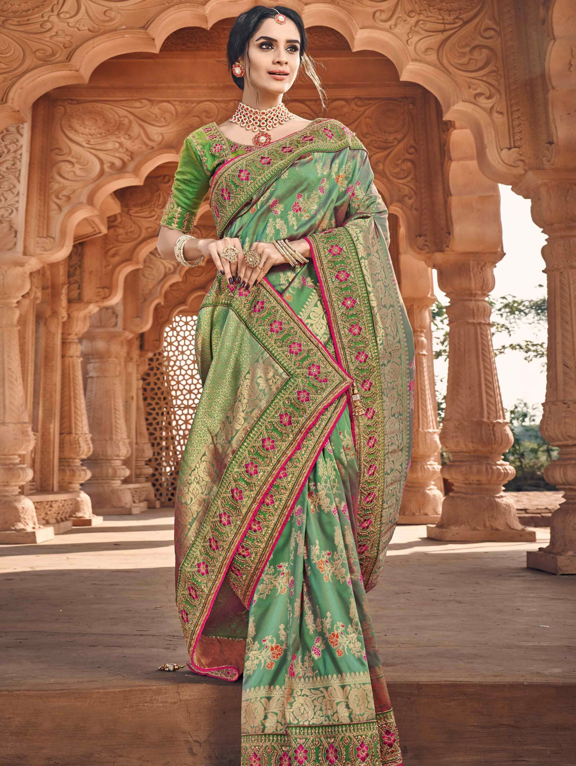 Green Banarasi Silk Traditional Woven Saree with Pink Highlights and Double Blouse